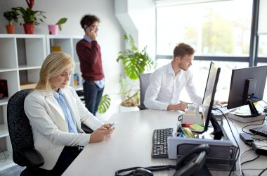 business team with smartphones at office